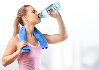 woman drinking mineral water after sport