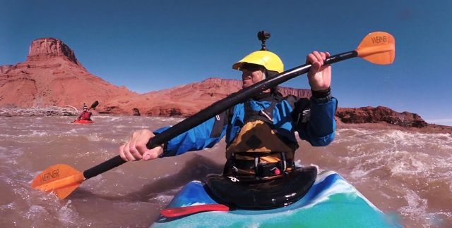 Man with camera on canoe