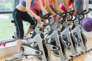 women on spinning in gym